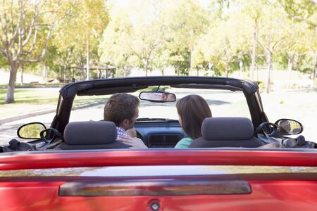early thirties: Couple in convertible car