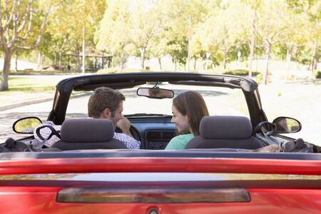 Couple in convertible car smiling Stock Photo - 3603719