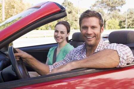 cabriolet: Couple in convertible car smiling Stock Photo