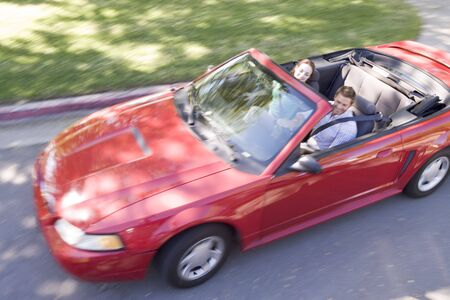 new motor car: Couple in convertible car smiling Stock Photo