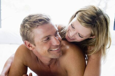 Couple lying in bed smiling Stock Photo - 3603649