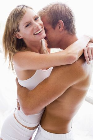 two sexy women: Couple bedroom embracing and smiling Stock Photo