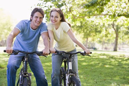 Couple on bikes outdoors smiling Stock Photo - 3603388