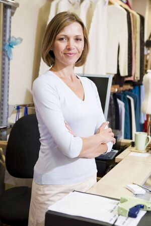 checkout stand: Woman at clothing store smiling