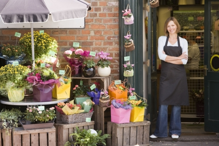 flower shop: Woman working at flower shop smiling Stock Photo