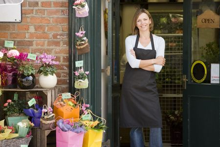 proprietor: Woman working at flower shop smiling Stock Photo