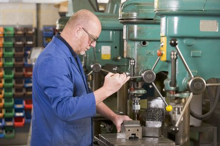 tradesperson: Machinist working on machine
