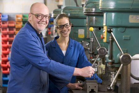 Two machinists working on machine Stock Photo - 3603696