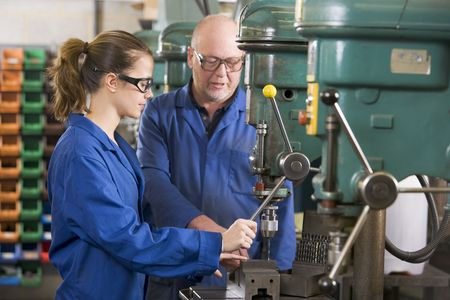 factory worker: Two machinists working on machine Stock Photo