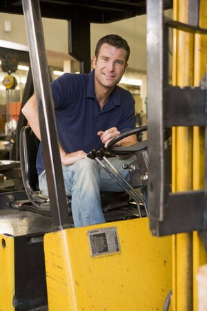 Warehouse worker in forklift Stock Photo - 3603641