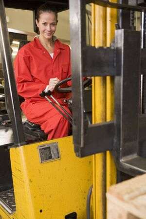 tradesperson: Warehouse worker in forklift Stock Photo