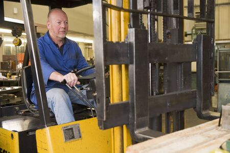 Warehouse worker in forklift photo