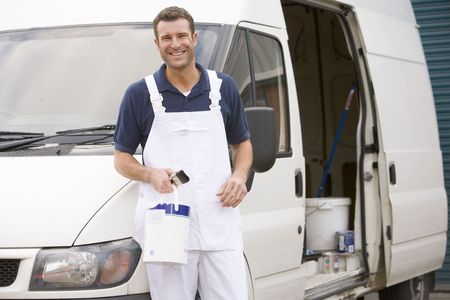 decorator: Painter standing with van smiling