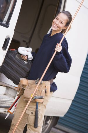 plumber tools: Plumber standing with van smiling Stock Photo