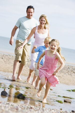 Family running at beach smiling photo