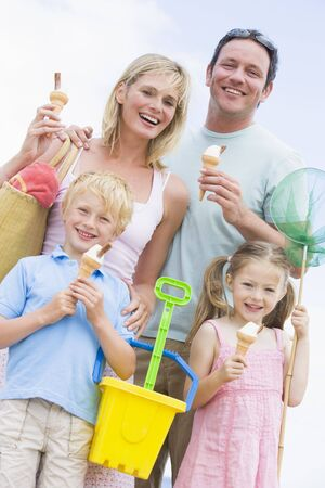 Family at beach with ice cream cones smiling photo