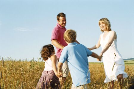 Family playing outdoors smiling photo
