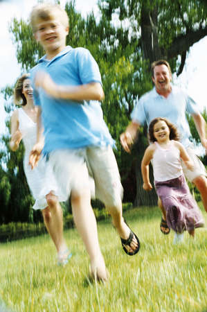 Family running outdoors smiling Stock Photo - 3603161