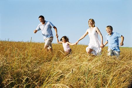 Family running outdoors holding hands smiling Stock Photo - 3603135