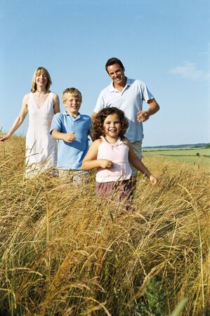 Family running outdoors smiling Stock Photo - 3603134