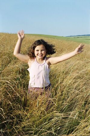 Young girl running outdoors smiling photo