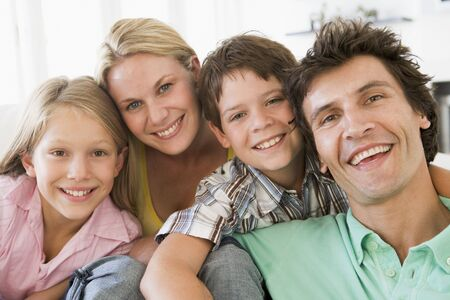 Family in living room smiling Stock Photo - 3603249