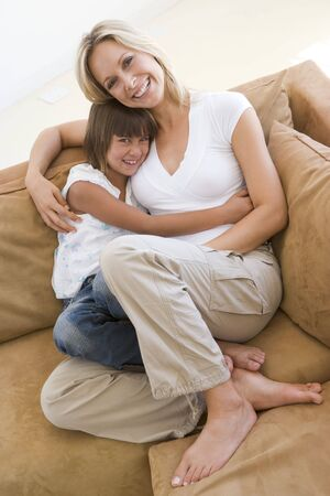 Woman and young girl sitting in living room smiling Stock Photo - 3602834