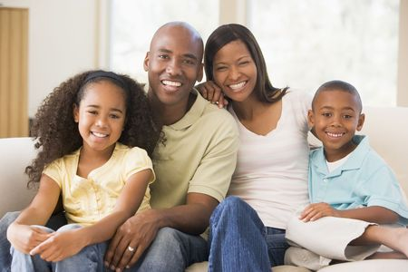 Family sitting in living room smiling photo