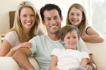 Family sitting in living room smiling Stock Photo - 3602747