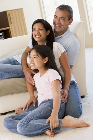 Family in living room smiling photo
