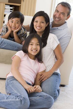 filipino people: Family in living room smiling Stock Photo