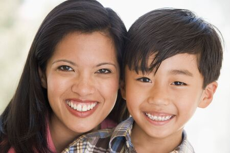 young boy smiling: Woman and young boy smiling Stock Photo