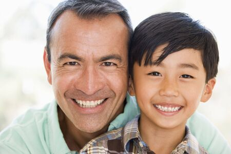 father and child: Man and young boy smiling