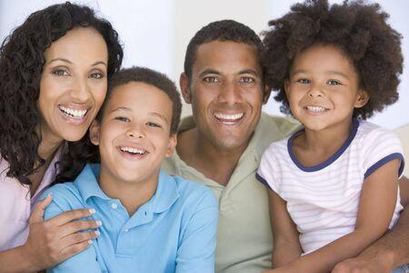 Family in living room smiling Stock Photo - 3602862