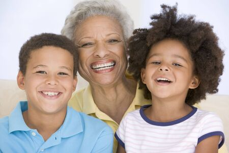 grandma: Woman and two young children smiling Stock Photo