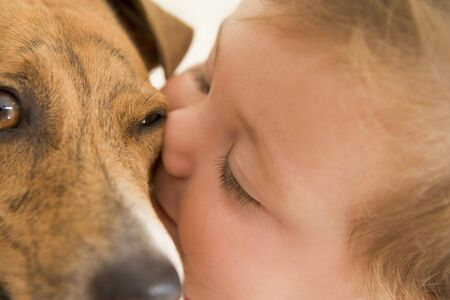24 month old:  kissing dog Stock Photo
