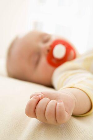 Baby lying indoors sleeping Stock Photo - 3600529