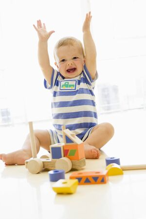 Baby indoors playing with truck Stock Photo - 3600531