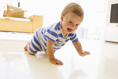 crawling: Baby crawling in living room Stock Photo