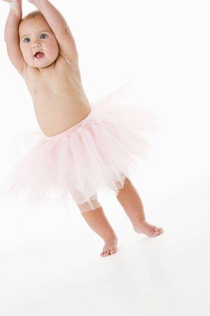 Baby standing in tutu photo