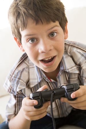 Young boy holding video game controller photo