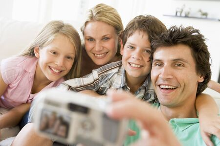Family taking self portrait with digital camera Stock Photo - 3603554