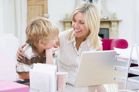 Woman and young boy in home office with laptop smiling Stock Photo - 3601066