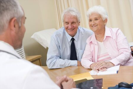 consultation woman: Couple in doctors office smiling