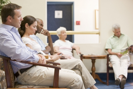 waiting room: Five people waiting in waiting room Stock Photo