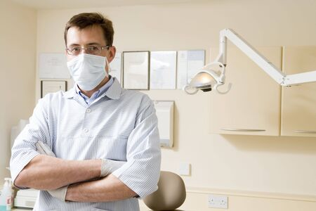 surgical mask woman: Dentist in exam room with mask on Stock Photo