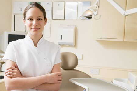 Dental assistant in exam room smiling photo