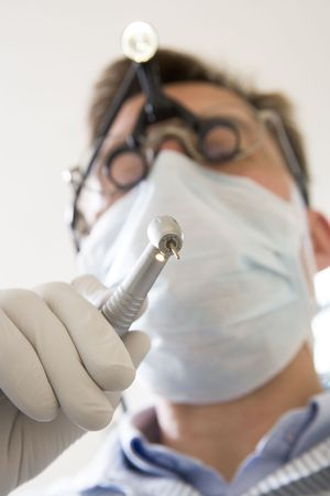 Dentist holding drill Stock Photo - 3600583