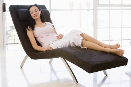 Woman sitting in chair sleeping Stock Photo