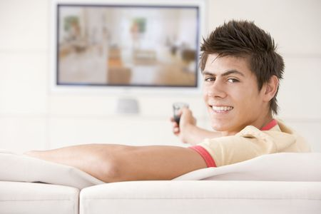 Man in living room watching television smiling Stock Photo - 3482439